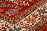 Intricate repeating designs in varied colours form the outer border which set well against the lovely vibrant red.