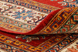 have a look at the back of a carpet, you can easily spot a machine made rug that is being passed of as hand made