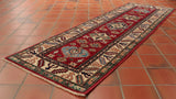 This Afghan Kazak runner is 182 x 58cm (5'11 x 1'11) in size