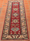 The rich red found in this Kazak runner is strong, but allows for other colours to flow through.