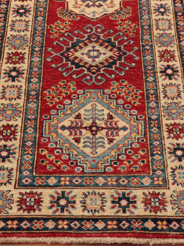 A simple geometric pattern flows effortlessly throughout this lovely Afghan Kazak runner