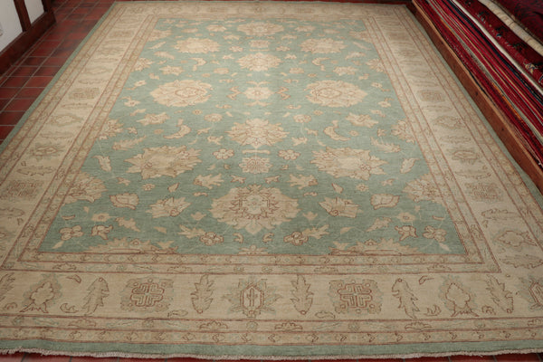 The duck egg blue background of this Ziegler is complimented by a cream and oatmeal border. They have used a soft terracotta for highlights on the subtle floral design. This carpet has a muted colour giving it an aged appearance. This piece would look stunning in a drawing room or sitting room, it has a calming look and feel to it.