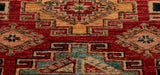 The main colour used in the Kazak rug is a warm brick red and they have used cream, soft blue and dark blue to highlight the design.