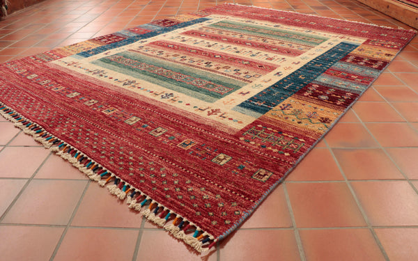 A stunning Afghan hand made rug will bring richness and fun to a room.