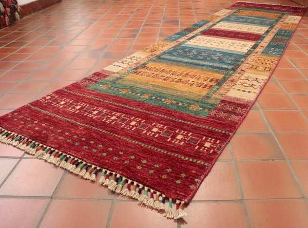 This long Afghan Loribaft runner is 315 x 80cm (10'4 x 2'8) in size