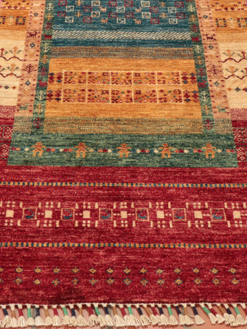 This Afghan Loribaft runner features a frame design not dissimilar to Gabbeh designs
