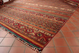 The fringe on this rug is treated in a unique way, Sevral of the wefts are gathered together and wound  in brightly coloured wool. These are a feature of these lovely Samarkand pices