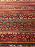 Lovely large Afghan Carpet in colours of terracotta, orange, red, with some blue and ivory details
