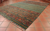This lovely Samarkand rug is 237 x 172cm (7'9 x 5'8) in size