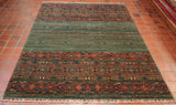 It is unusual to find rugs like this in a green hue of colouring