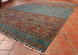 This fine Afghan Samarkand carpet is 290 x 204cm (9'6 x 6'8) in size