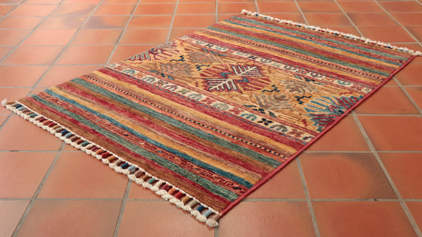 gentle colours include blue red brown sand and apricot are all featured in this hand made mat