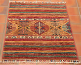 a caucasian design is in the middle of this small 3' x 2'1 rug