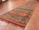 This Afghan Samarkand runner is 346 x 80cm (11'4 x 2'8) in size