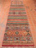 This specific Samarkand runner features 3 separated traditional patterns and 2 modern striped panels.