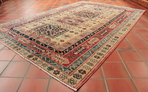 This Afghan Kazak is 203 x 138cm (6'8 x 4'6) in size