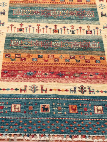 colourings of blue, green, cream, red and gold have been used in this hand made Afghan Loribaft rug