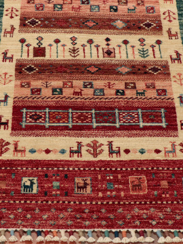 Colourings of red, brown, cream and green have been used in this Afghan rug.
