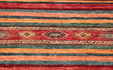 the Caucasian designs are in bands across the runner with some simple plain stripes of colour