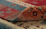 A nomadic look for this Afghan Loribaft rug.