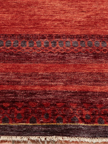 modern Afghan rug which is still authentic and made by hand