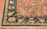 An interesting design has been used incorporating birds and animals including some winged mythical creatures. The whole rug is framed by a deep blue border containing more vases and pots that have come from an archeological dig. The rug is finely woven using wool on to a cotton foundation and parts of the pattern are made using silk.