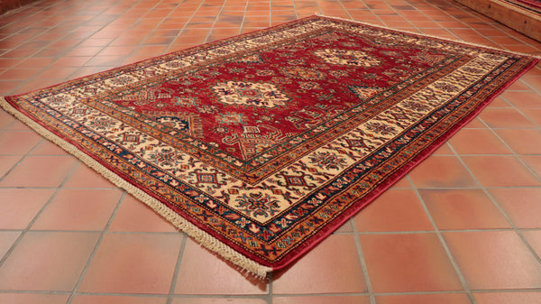 This fine Afghan Kazak rug is 170 x 123cm (5'7 x 4') in size