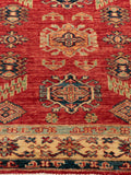 The main dominating colour used in tis Afghan Kazak is an orange red.