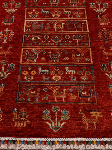 Beautiful rich red background to this Afghan Aryana runner