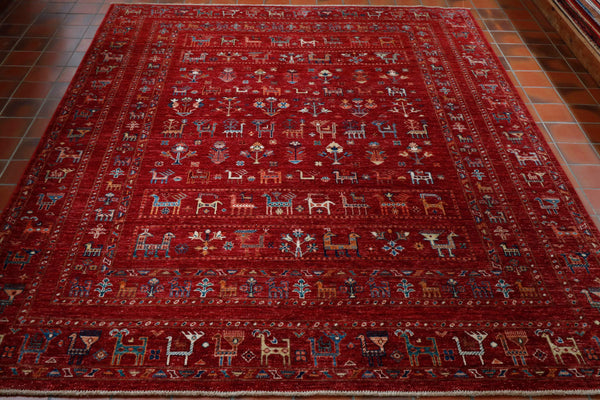 An interesting hand knotted Afghan Kharjeen rug that is littered with many stylised animals and birds, particularly goats and  peacocks. The rug is made using the robust Afghan wool woven on to a cotton warp and weft. A characterful rug that will look good in any room in the house.