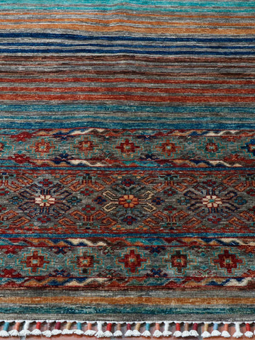 A fine Afghan  hand made rug measuring approximately 6 foot by 4ft.