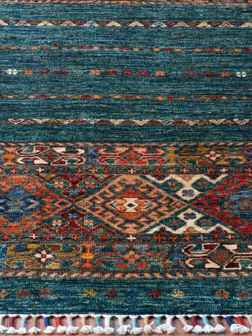 This samarkand rug is 125cm 78cm. The Turquoise is quite unusual particularly attractice with jewel like colours from the old Caucasian design used at both enmds