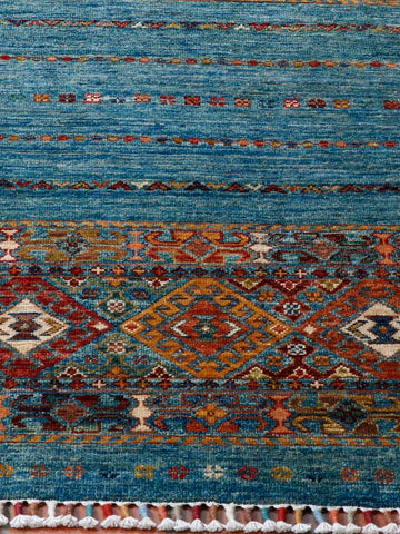 This small blue Samarkand rug has a lovely Caucasian design crafted into it