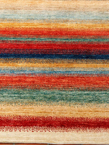 a stripy rug with vibrant colours makes this an unusual carpet