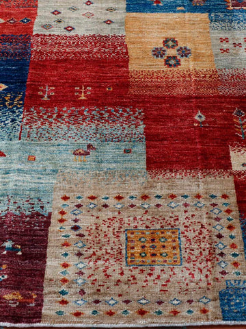 A lovely vibrant hand made rug is produced by Afghan weavers using traditional methods and beautiful wool
