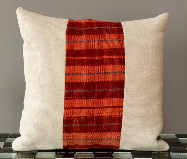 Panelled kilim cushion with the outer pieces being a plain cream and an orange and red check in the centre