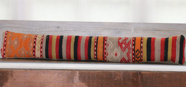 colourful draught excluder using orange, gold, grey and black stripes.