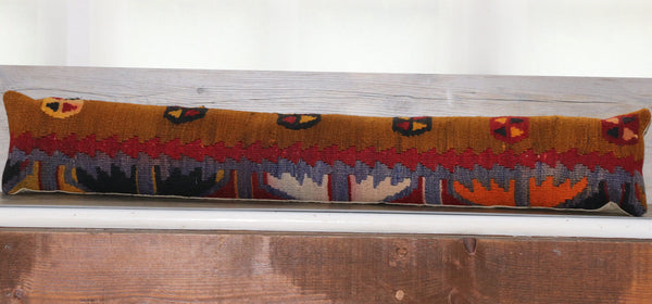 colours of tan, brick red, orange, black and blue in this draught excluder