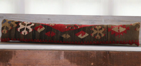 Draught excluder with soft brown, red, beige and cream detail