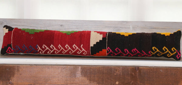 old Turkish kilim in red and dark brown with some areas of gold and bright green.