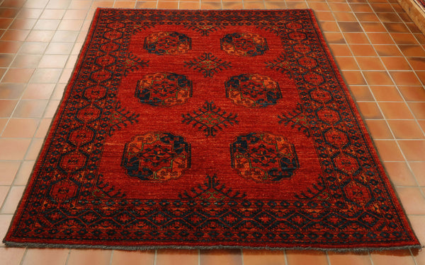 This Afghan Ersari rug has a lovely wool pile as you may expect. The design is based upon the classic gol or elephant foot, which is repeated as 6 large designs in the centre ground. The rug is mainly burnt orange with very deep blues and hints of green. It is an excellant example of a traditional Ersari piece.All of our rugs are unique and so you can never find 2 the same!