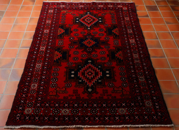 Afghan Belouch rugs are made from 100% wool. The colourings are fairly limited to just red, brown, dark blue and touches of cream, this certainly makes them very practical. The designs are inevitably geometric patterns and often prayer rug design. For a hand made rug they offer excellent value for money.