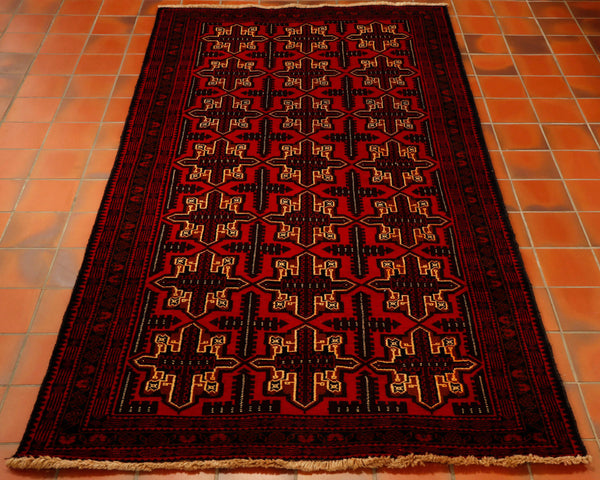 deep red cream and brown colourings have been used in th Afghan Belouch tribal rug