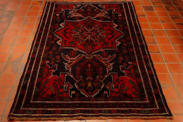 This is a hand knotted tribal rug made from 100% wool and features a large central medallion. The colouring is dark brown, vibrant red and some bottle green. These rugs are a fantastic quality and relatively inexpensive.