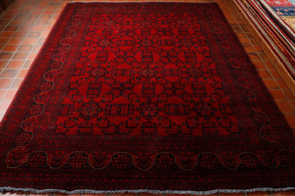 Rich red background with the traditional all over pattern in dark blue . These rugs and carpets are very practical and hard wearing. For a hand made wool carpet this certainly represents excellent value for money.