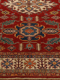 traditional Afghan Kazak rug with a red ground colour