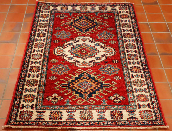 Traditional Caucasian design in strong colours of red, blues and contrasting with an ivory border. The wool is vegetable dyed and hand spun with gives the colour character and the wool such texture.