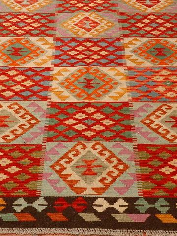 Strong terracotta, pale blue, old gold and green are amongst the colours used in this kilim. it is edged in dark brown.