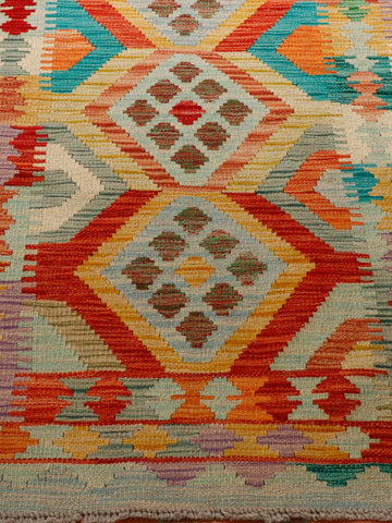 great colours in this kilim of turquoise, gold, terracotta, green and red.