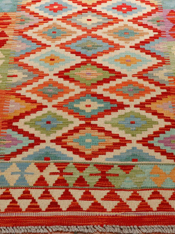 Colourful kilim, however, it might be easier to say which colour isn't in this kilim.